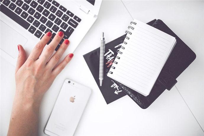 woman-hand-smartphone-desk-large.jpg